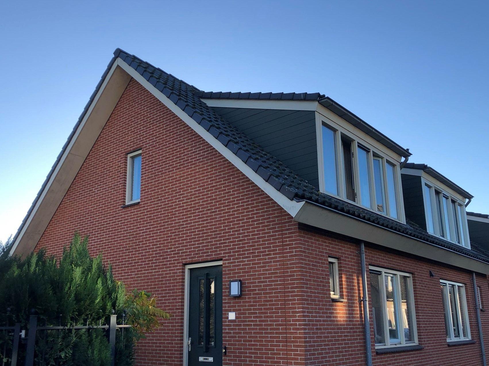 Dakkapel ontwerp schuin dak op woonhuis